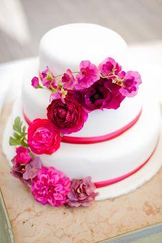 wedding cake with flowers in #radiantorchid  - photo by Piteira Photography - http://ruffledblog.com/portuguese-beach-wedding/