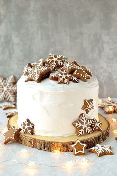 Rich Christmas fruitcake topped with marzipan, royal icing and gingerbread