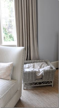 I love the grey blue walls with the beige linen drapes, the nail head detail and the little wicker dog bed painted grey Living Room White, White Rooms, Home Living Room, Blue Gray Bedroom, Blue Grey Walls, Curtains For Grey Walls, Linen Curtains, Bed Linens, Up House