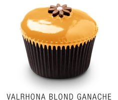 Georgetown Cupcake | DC Cupcakes | Menu | Valrhona chocolate cupcake topped with a Valrhona Blond ganache frosting and fondant flower