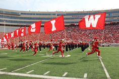 The spirit squad leads the Badger team onto the field vs. Tennessee Tech.