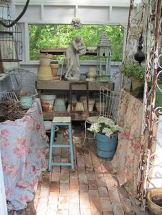The inside of a potting shed built with old doors and windows