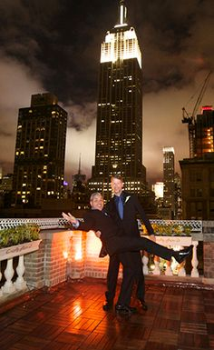 Just Married in NYC with Empire State Building behind them - Gay Wedding at Midtown Loft & Terrace