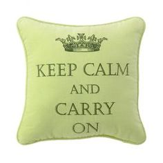 """Bright velveteen pillow with a twist on the British """"Keep Calm"""" slogan and matching piped trim."""
