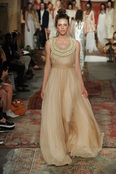 Golden flowing dress by Houghton Spring/Summer 2016 Collection. Photography: Courtesy of Houghton Bride. Read More: http://www.insideweddings.com/news/fashion/houghton-springsummer-2016-collection/1860/