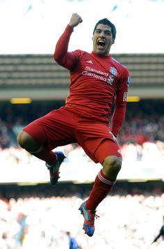 Liverpool's Luis Suarez celebrates after scoring the first goal of the game for his side during their English FA Cup quarterfinal soccer match at Anfield Stadium, Liverpool, England, Sunday March 18, 2012. (AP Photo/Clint Hughes)