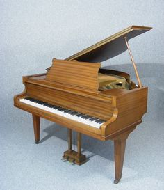 A beautiful Mahogany cased Challen Baby Grand, ready to play.  Originally supplied by Harrods we estimate the serial number to date the Piano to the 1950's.   The Piano has a Schwander Action which is still balanced, precise and light to the touch  The tone is bright and very well defined in the bass octaves.  There are no known faults, but please bear in mind that having been moved a couple of times the piano will need fine tuning to bring it back up to its full potential.  The case is in…
