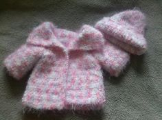 Crocheted baby hat and sweater gift for baby shower