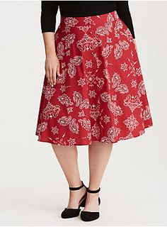 "A skirt that you could wear to a sock hop with your honey, this midi length style roars to retro life with a red and white paisley print cotton. The button front keeps the look fitted along with the zip back.<div><ul><li style=""list-style-position: inside !important; list-style-type: disc !important"">Size 14 measures 28"" from center front</li><li style=""list-style-position: inside !important; list-style-type: disc !important"">Cotton/spandex</li><li style=""list-style-position: inside…"