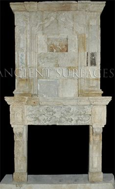 Antique stone fireplace with a top trumeau