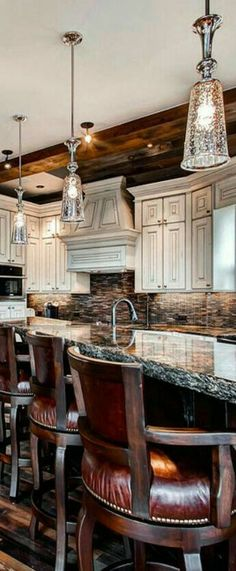 Love the pendant lamps, the bar stools, the countertop and more.  Pretty nice kitchen.