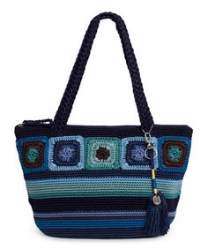 A stylish design in feminine crochet soups up this shoulder bag for an incredible look! Featuring interior pockets for organizing accoutrements, the sweet and sassy handbag handles every toting need while finishing ensembles in style.