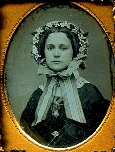 Photograph of a beautiful lady in a floral bonnet, mid-nineteenth century