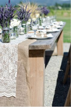 rustic weddings at red barn ranch great idea burlap and lace table runners/llavender and lilacs in mason jar center peices