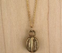 Coffee Bean Necklace- interesting that it doesn't look like a real coffee bean. Mine, however, is real. Jewelry Box, Jewelery, Jewelry Accessories, Fashion Accessories, Jewelry Ideas, My Coffee, Coffee Beans, Real Coffee, Ideas Joyería