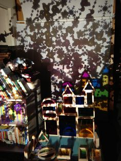 projected patterns and color with overhead projector, plastic necklaces, and blocks