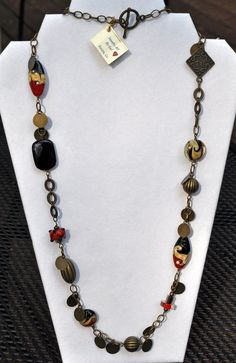 brass lamplight bead necklace in reds tans and by JewelryArtByGail