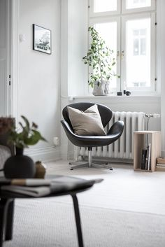 White floors and a beige wall