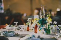 Mojave Desert Wedding  -  good visual on the idea for vases/floral design.  multi-colored, mix match shape/sizes, different sporadic flowers