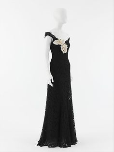 """Evening dress House of Chanel (French, founded 1913) Designer: Gabrielle """"Coco"""" Chanel (French, Saumur 1883–1971 Paris) Date: 1937–38 Culture: French Medium: silk, rayon, horsehair, linen Dimensions: Length at CB: 47 in. (119.4 cm) Credit Line: Gift of Mlle. Chanel, 1955"""