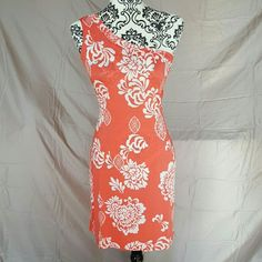 "Floral One Shoulder Pinup Dress This dress is One Size. See measurements. It does have a ton of stretch. I would say it would fit best on S-L. It is a lovely coral red with white hibiscus floral print.   ??Measurements (laying flat, unstretched) Bust-16"" Waist-15"" Hips-18"" Length-35"" (from top of strap to bottom) India Boutique Dresses Midi"