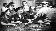 Slot machines are smashed under an anti-gambling campaign in New York led by Mayor LaGuardia.. September 1934.