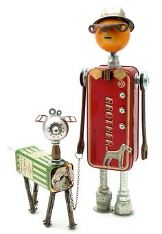 """""""Momo Goes Walkies""""   Height: 13.5""""   Principal Components: Sewing machine attachments tin, pool ball, sash lock, oil lamp burner, wrenches, hose fittings, talc tin, tea ball, expansion bolts, slide buckles, spring, pocket watch"""