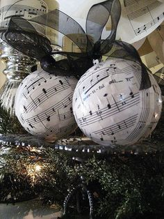 easy and inexpensive christmas decorations from sheet music, christmas decorations, crafts, seasonal holiday decor, wrea Sheet Music Ornaments, Music Christmas Ornaments, Sheet Music Crafts, Noel Christmas, Homemade Christmas, Christmas Balls, Diy Ornaments, Black Christmas, Musical Christmas Decorations
