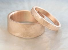 handmade wedding ring set -- 8mm and 3mm hammered rose gold wedding bands -- his and hers. $1,368.00, via Etsy.
