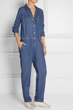 MICHAEL Michael Kors' denim jumpsuit will slot perfectly into your off-duty wardrobe. This soft and supple Tencel and cotton-blend style has an elasticated waist and snap-fastening tabs to subtly define your shape. Roll the cuffs to create a cropped silhouette.