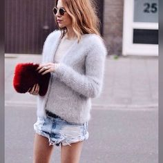 Last Warm And Fuzzy We Have Today A #fur #clutch To Keep The Cold At Bay #handbag #streetstyle #pfw #style #mode #bigsweater #denim #ripped #highlow #nyc #fall #furfashion #manoswartz #est1889