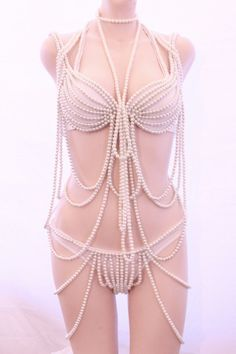 I could never wear this but I would love to make something like this someday for someone with the body to pull it off. Peals accented with colored gems.