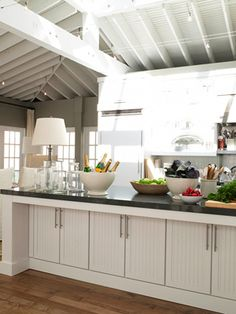 2. Ina likes gutsy countertops, super-thick and dark. Ultra-durable CaesarStone in Raven adds a nice contrast to KraftMaid's Brookfield Maple cabinets in Dove White. 3. Keep the fridge close by. Here, the work space is bookended with Viking's Quiet Cool all-refrigerator and all-freezer (No. 10).