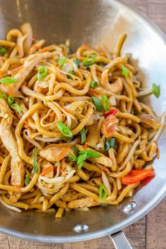 Chicken Lo Mein with chewy Chinese egg noodles, bean sprouts, chicken, bell peppers and carrots in under 30 minutes like your favorite Chinese takeout. #chinesefoodrecipes