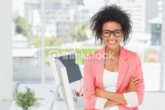 Stock Photo : Casual female artist with arms crossed at bright office