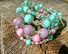 Bracelet of beads pink. Wide bracelet with memory. Exclusive decoration hand. Multilayer bright bracelet for all sizes. Bracelet in one copy