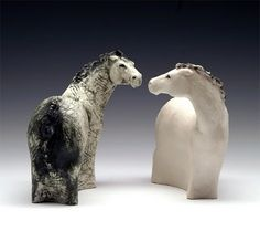Yin and Yang Horses by Anne Russell - I like how the problems of thin horse legs are eliminate, but the shape and grace are still implied.   Perhaps option for stretching cat?