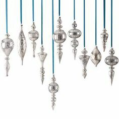 "Mercury glass ornaments with spindle silhouettes.    Product: 15 Piece ornament set   Construction Material: Glass   Color: Silver   Dimensions: 4"" H each (approximate)    Cleaning and Care: Wipe with dust cloth"