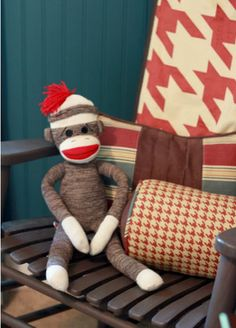 A sock monkey is a great vintage touch to this car-themed room. It's vintage without being too theme-y and lends to the color pallet used in the room. My son's is personalized and was made by a local vendor at the farmers' and craftsmen market. I love the Red Houndstooth, too!
