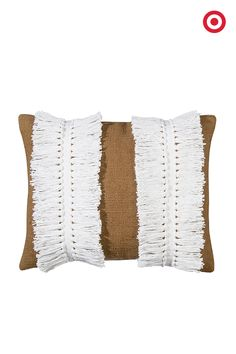 For a sophisticated décor pick-me-up, give fringe a try! Thanks to Nate Berkus for adding some fringe to his spring collection with gorgeous pieces like this decorative pillow—just what your couch's been waiting for.