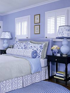 Love all things blue and white? Then this bedroom is for you. I would not paint the walls blue but white.  It will create a fresh and clean feel, but the real charm comes from the mix of patterns and shades of periwinkle. A solid comforter keeps the combination of fabrics and colors from looking too busy. All the accessories -- from the lamps' blue-and-white shades to the blue-and-white rag rug --complement the scheme. Dark nightstands provide a bit of visual relief.