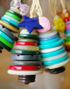 This is a great #holiday #craft for the kids. Just gather some old buttons that can be stacked into cute trees and create ornaments.