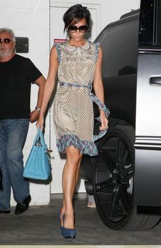 Who made Victoria Beckham's blue shoes, blue purse floral dress and sunglasses? Sunglasses – Cutler and Gross  Shoes – Yves Saint Laurent Tribute Two Blue Suede Pumps  Dress – Marc by Marc Jacobs Cloud Flower Print Dress  Purse – Hermes Birkin Bag in Blue Jean