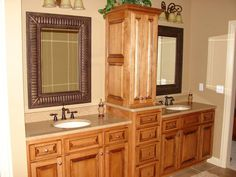 brown wooden bathroom cabinet with linen storage among two mirror and sink with faucet combined with wall lamp with corner linen cabinet tower also linen