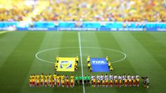 FORTALEZA, BRAZIL - JULY 04:  (EDITORS NOTE: Image was created using a variable planed lens.) Players of Brazil and Colombia line up prior t...