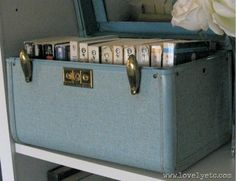 suitcase of books Tips for Styling Bookcases and Built-Ins