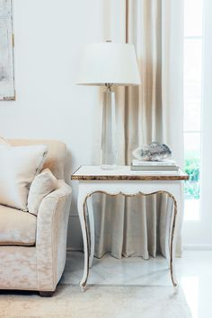 Small enough to sit next to a seating piece but large enough to stand alone, the Louis XV style Regent End Table from Ave Home features a hand-applied layered white finish and gilded edging.