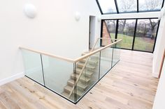 Our embedded glass is an excellent solution for your landing balustrade. It keeps obvious fixings to a minimum and provides an unobstructed view of your state-of-the-art staircase. Staircase Handrail, New Staircase, Floating Staircase, Staircase Design, Bespoke Staircases, Wooden Staircases, Interior Styling, Interior Decorating, Wood Steps