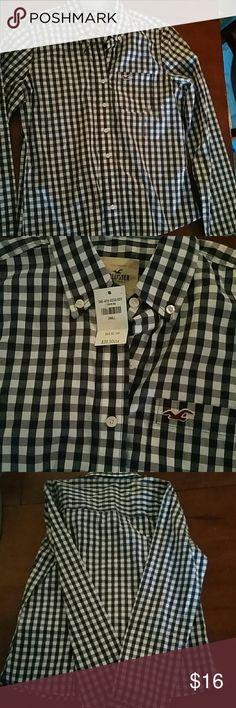 NWT Hollister Blue and White Button Down Shirt Hollister Blue and White Button Down Shirt  *Brand new with tags, never worn!  *Navy blue and white checkered pattern *Long sleeve *Collared  *Size small *100% Cotton  ☆ Reasonable offers accepted! Bundle with other pieces from my closet and save!! Hollister Tops Button Down Shirts