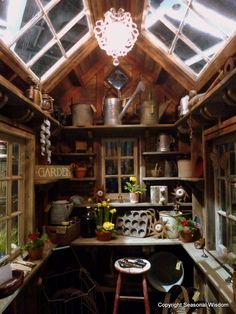 Garden shed/potting shed.  I like the inside shelves, particularly the ones high up at the ceiling line & the skylights made from old windows.